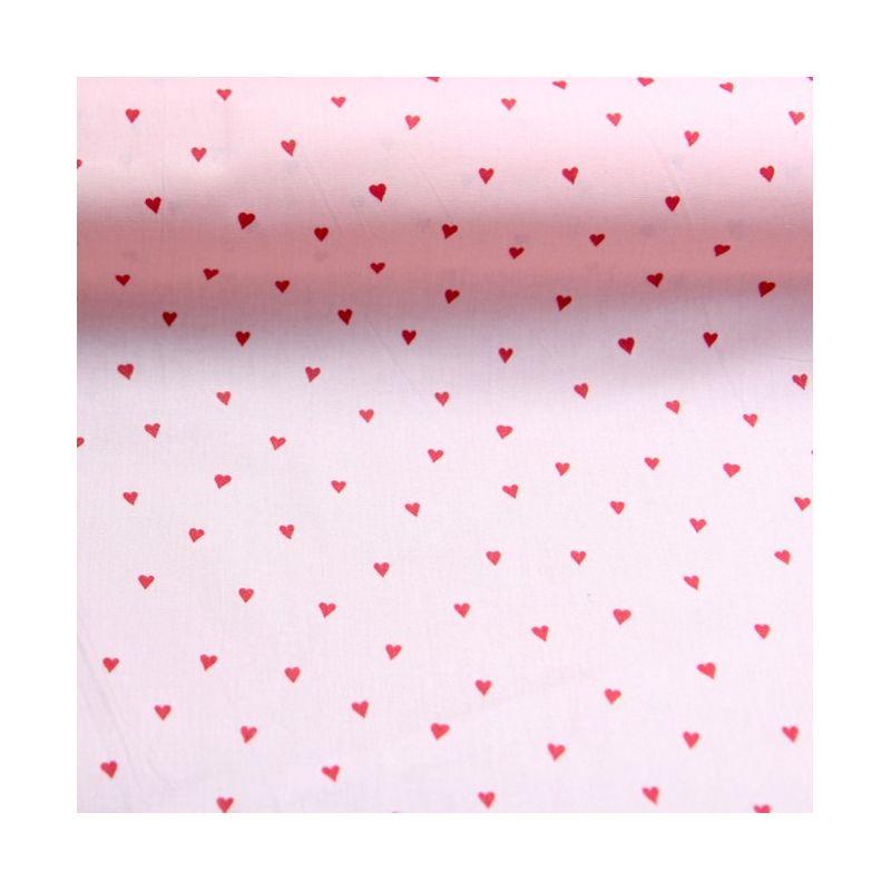 Coton enduit rose petits coeurs